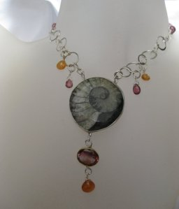 Pick #6Wanga Talisman Necklace with Pink Tourmalines Spessartite Garnets (for good luck when given as a gift, constant affection and loyalty) and an Ammonite fossil (the unending spiral of life - holds the power of wisdom).